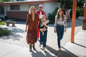 McFARLAND, USA L to R: (Maria Bello), Coach Jim White (Kevin Costner), Jamie White (Elsie Fisher) and Julie White (Morgan Saylor).  Ph: Ron Phillips ©Disney 2015